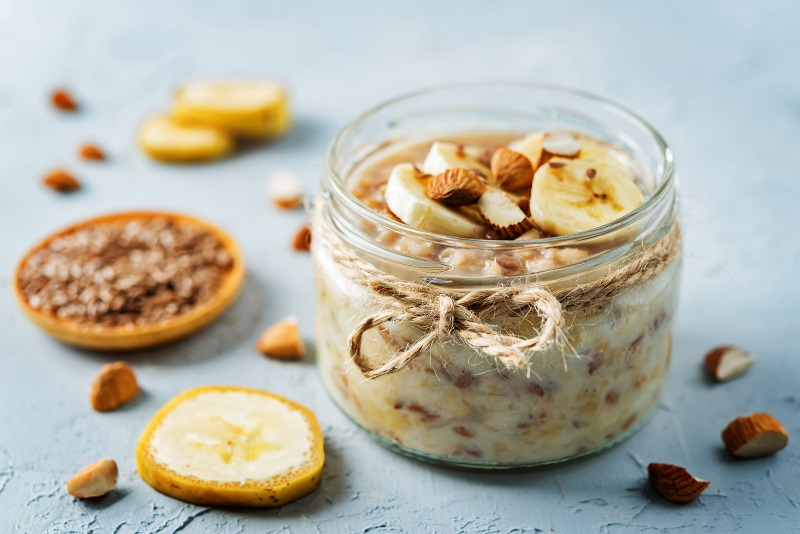 Overnight oatmeal with banana slices and almonds